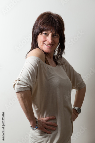 Woman with arms akimbo