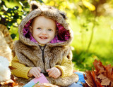 funny baby boy  in fall