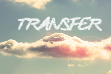 Transfer against bright blue sky with cloud