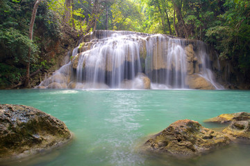 Waterfall in Erawan National Park with rocks