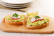 Two sandwiches with avocado and radish