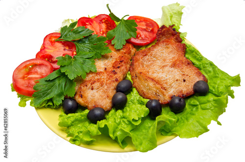 Pork chop with vegetables, salad and olives