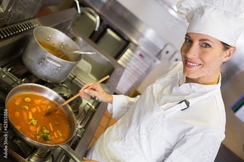 Female cook preparing food in kitchen