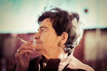 old lady smoking a cigar