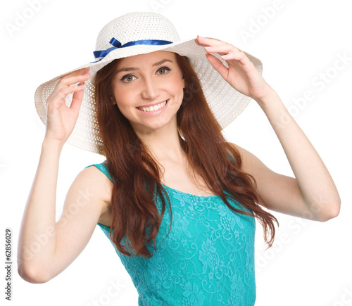 Pretty woman wearing summer hat