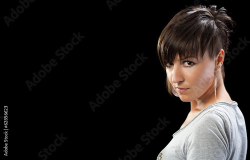 Girl with cute eyes and modern shortcut hairstyle posing and