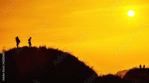 silhouette of traveller on top of mountain when sunset