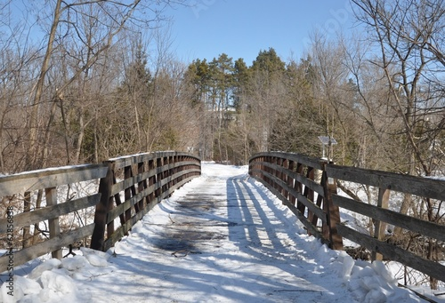 Snow covered wooden bridge