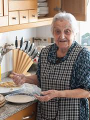 Elderly woman preparing croquettes