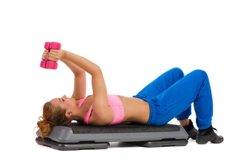 Female Exercise On Aerobic Step With Hand Weights