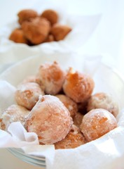 Fresh fried donuts powdered by a sugar.