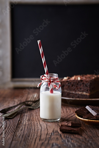 Bottle of Cold Milk with Paper Straw