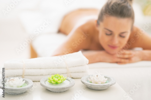 Closeup on spa elements and young woman in background