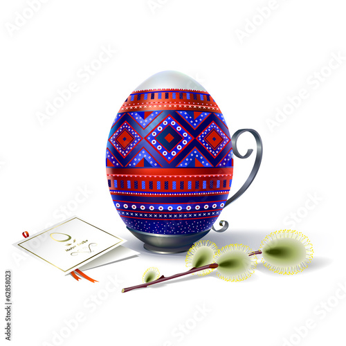 Easter egg with multicolored ornament and sprig of willow