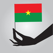 Burkina Faso flag in his hand