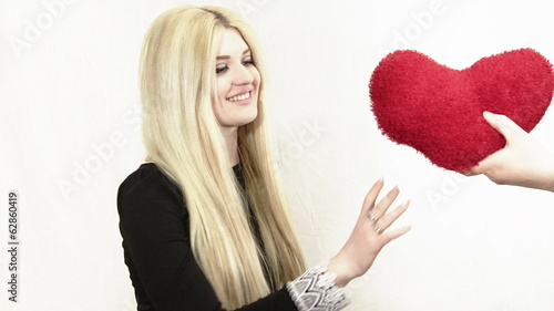 Woman receives as a gift heart from a hand of  a boyfriend