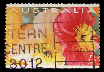 Stamp printed in Australia shows red and yellow flowers