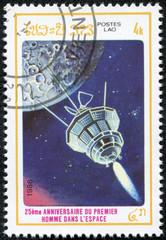 stamp printed in Laos shows satilite