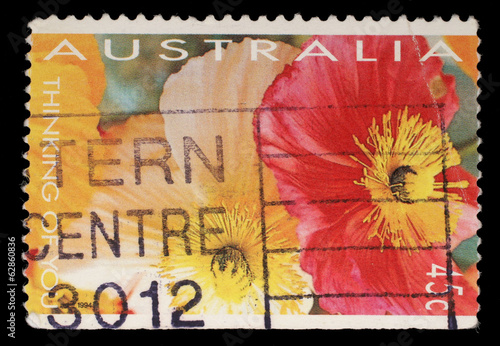 Poster Stamp printed in Australia shows red and yellow flowers