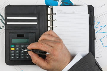 Businessman considers on the calculator