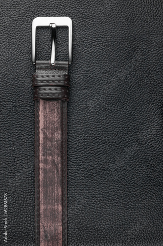 Brown belt lies on the natural leather