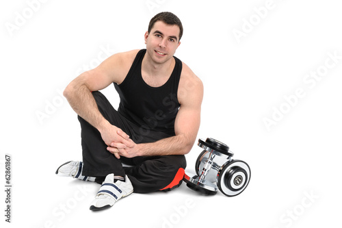 young man posing with dumbbell