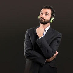 Young businessman listening music