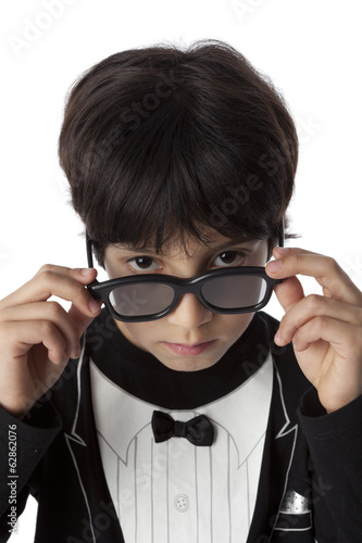 Well dressed eight year old boy with sunglasses