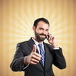 Young businessman talking to mobile