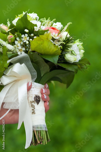 wedding bouquet in hands. inscription love