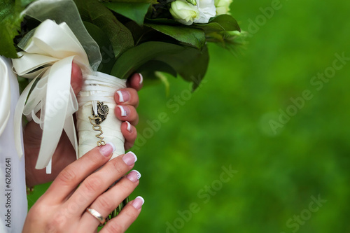 wedding bouquet in hands. inscription love. close-up