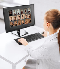 editor choosing pictures from computer monitor