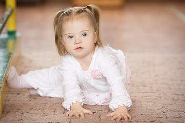 Cute little girl with Down syndrome
