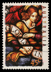 Stamp, Australia shows Angel with Gloria in excelsis Deo Banner