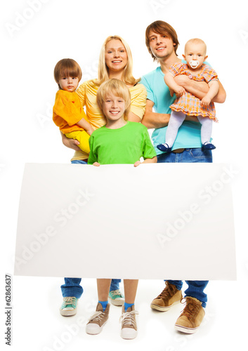 Young family with blank advertising banner