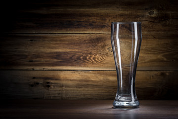 empty beer glass on a wooden background