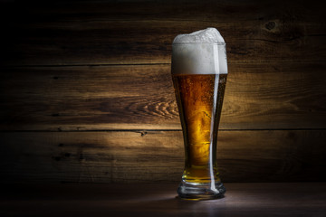 glass of beer on a wooden background