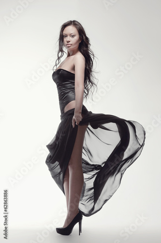 gorgeous asian woman in black dress