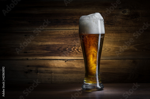 glass of beer on a wooden background - 62863892