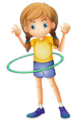 A young girl playing with the hulahoop