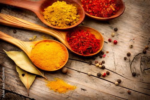 Various spices and herbs over wooden background