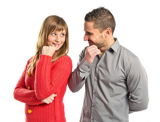 Couple looking at each other over white background