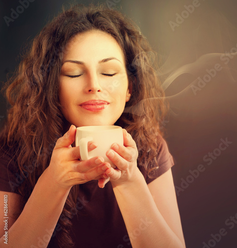 Beauty Woman With Cup of Coffee or Tea