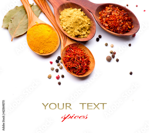 Spices and herbs. Curry, saffron, turmeric, cinnamon over white