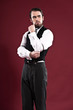 Retro 1900 victorian fashion man with beard wearing black gilet