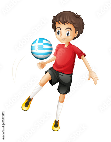 A young football player using the ball from Greece