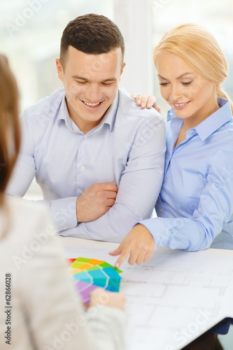 couple looking at blueprint and color samples