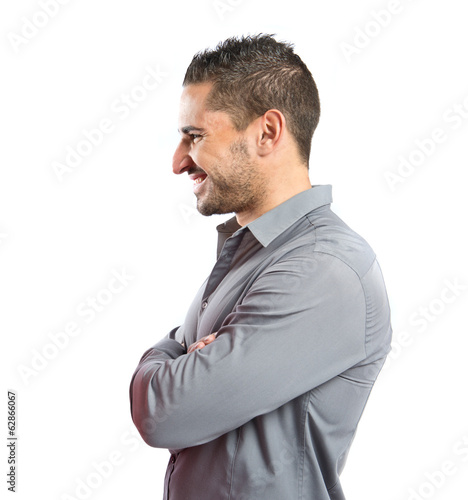 Handsome man with arms crossed over isolated background