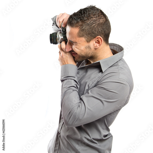 Man photographing over isolated background.
