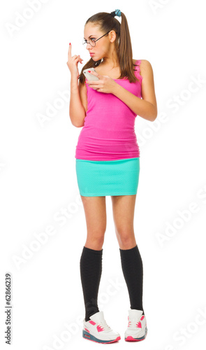 Young schoolgirl with mobile phone